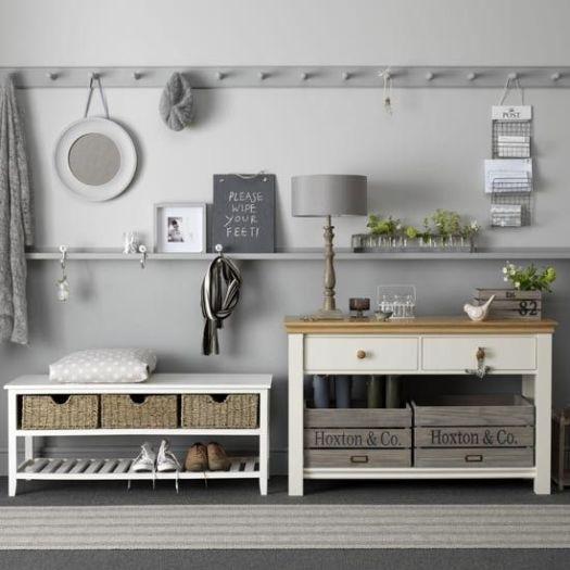 Grey shelving and coat hooks